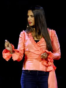 """Samina Ali on stage at her TedX talk """"What What Does the Qur'an Really Say about a Muslim Woman's Hijab?"""""""